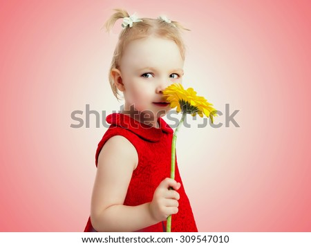 five year old girl with a yellow flower, isolated against studio background - stock photo