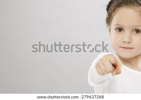 Five years girl pointing with finger - stock photo