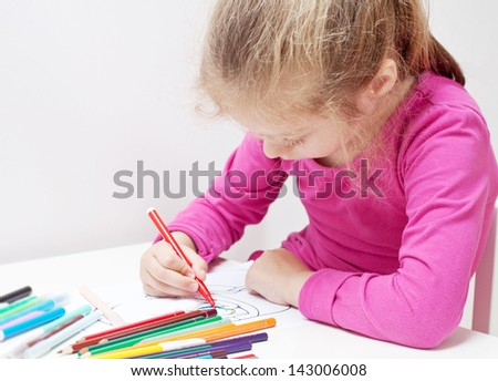 Five years old caucasian blond child girl drawing picture - stock photo