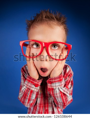 Five years old little boy with expressive face - stock photo