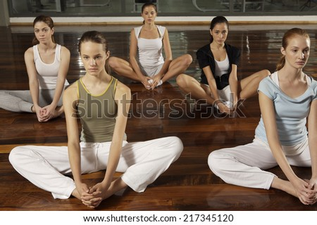 Five young women exercising - stock photo