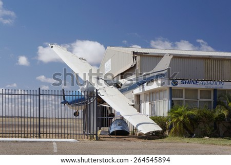 Fixed-wing light aircraft being damaged after Cyclone Olwyn on March 2015 in Western Australia.                                - stock photo
