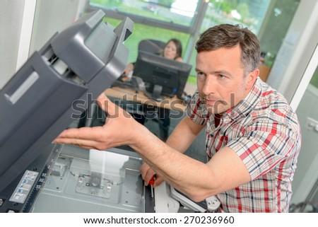 Fixing a printer - stock photo