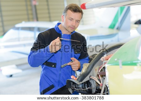 fixing an aiplane - stock photo