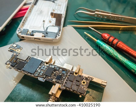 Fixing Smartphone Concept, Circuit Board, Water Drop - stock photo