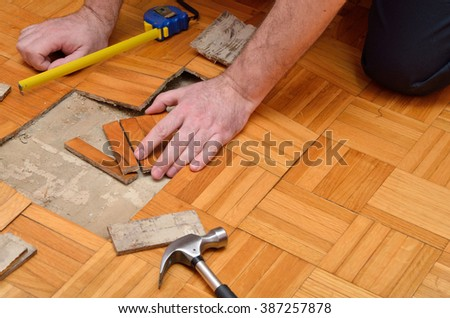 Fixing wooden floor in the apartment damaged by moisture or water - stock photo