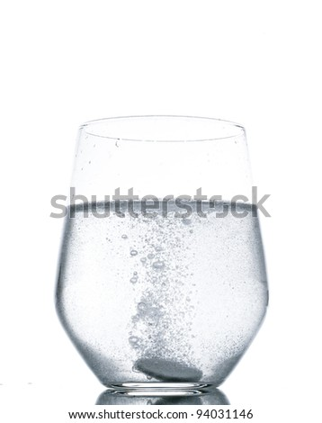 fizzy tablet in glass of water