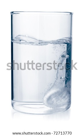 Fizzy tablet in glass of water isolated on white - stock photo