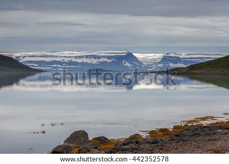 Fjord at Iceland with in the distance Vigur island - stock photo