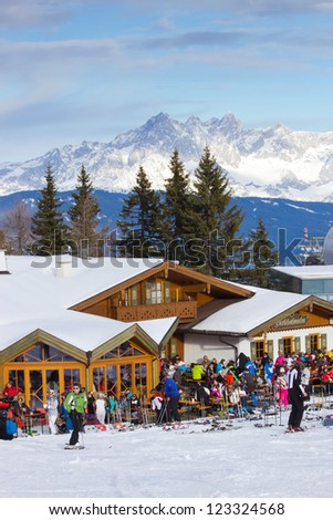 FLACHAU, AUSTRIA - DEC 27: People enjoying their winter sport on a piste in Austria on Dec 27, 2012. These pistes are part of the Ski Armada network, the largest of Europe - stock photo