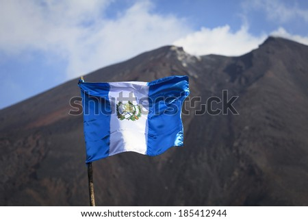 Flag against a volcano Pacaya in Guatemala, Central America - stock photo