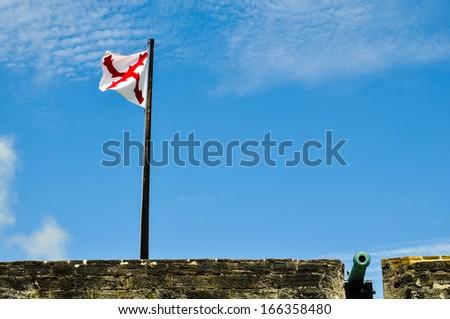 flag and cannon at historical castillo de san marcos, saint augustine, florida - stock photo