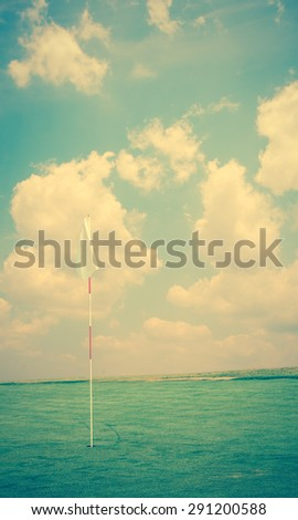 Flag and the golf field.vintage tone - stock photo