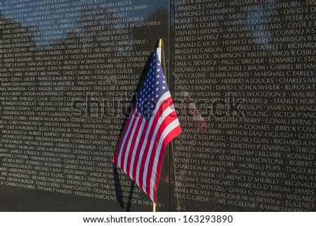 Flag at base of Vietnam Veterans Memorial - stock photo