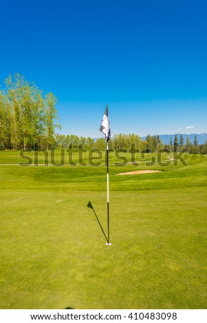 Flag at the beautiful golf course. - stock photo