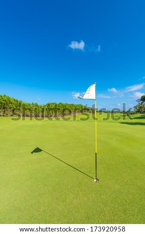 Flag at the golf course. Luxury mexican resort. Bahia Principe, Riviera Maya. Vertical. - stock photo