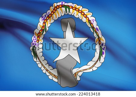 Flag blowing in the wind series - Commonwealth of the Northern Mariana Islands - stock photo