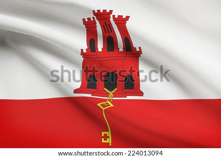 Flag blowing in the wind series - Gibraltar - stock photo
