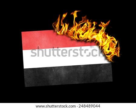 Flag burning - concept of war or crisis - Yemen - stock photo