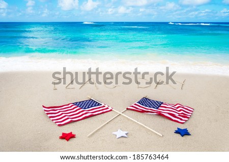 Flag day background on the sandy beach near ocean
