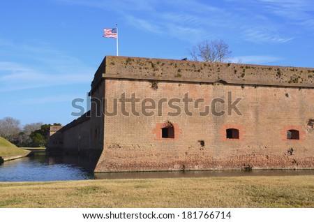 flag flying over Fort Pulaski  - stock photo