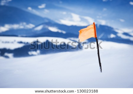 flag marker on the top of the mountain - stock photo