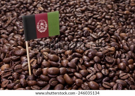 Flag of Afghanistan sticking in roasted coffee beans.(series) - stock photo