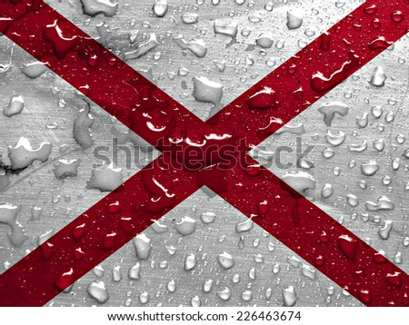 flag of Alabama with rain drops - stock photo