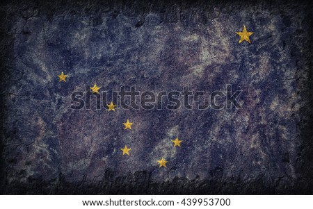 Flag of Alaska painted onto a rough wall - stock photo