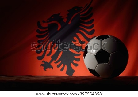 Flag of Albania with football on wooden boards as the background. MANY OTHER PHOTOS FROM THIS SERIES IN MY PORTFOLIO. - stock photo
