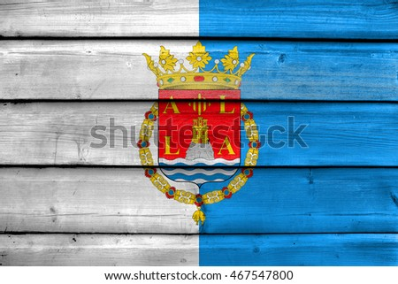 Flag of Alicante, Spain, painted on old wood plank background