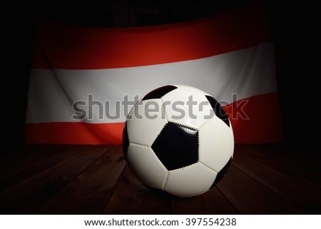 Flag of Austria with football on wooden boards as the background. MANY OTHER PHOTOS FROM THIS SERIES IN MY PORTFOLIO. - stock photo