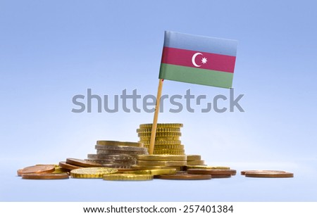Flag of Azerbaijan in a mixed stack of european coins and a blue background.(series) - stock photo