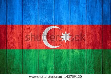 flag of Azerbaijan or Azerbaijani banner on wooden background - stock photo