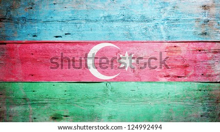 Flag of Azerbaijanpainted on grungy wood plank background - stock photo