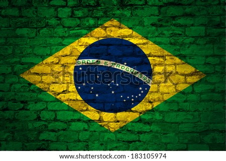 flag of Brazil painted on a stone brick wall with a vignette - stock photo