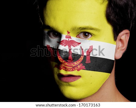 Flag of Brunei Painted on a Face of a Young Man