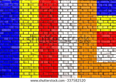 flag of Buddhism painted on brick wall