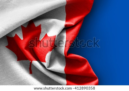 Flag of Canada on blue background - stock photo