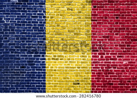 Flag of Chad painted on brick wall, background texture