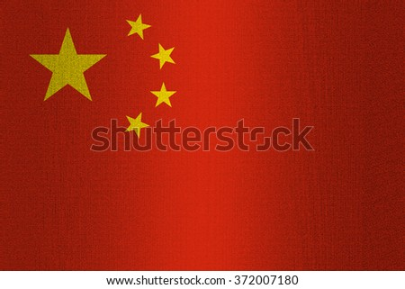 Flag of China on a stone wall background.