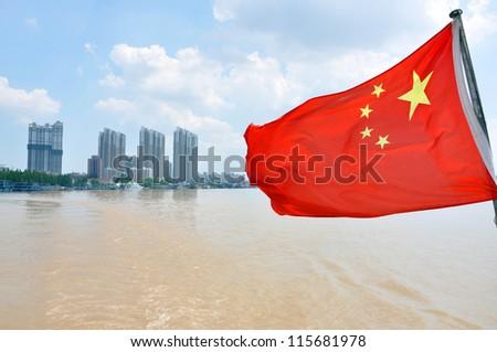 Flag of China on the Yangtze River in Nanjing, Jiangsu Province, China. - stock photo
