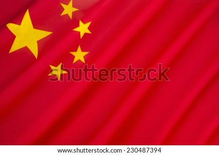 Flag of China - Red represents the communist revolution; the five stars and their relationship represent the unity of the Chinese people under the leadership of the Communist Party of China.  - stock photo