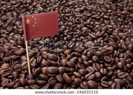 Flag of China sticking in roasted coffee beans.(series) - stock photo