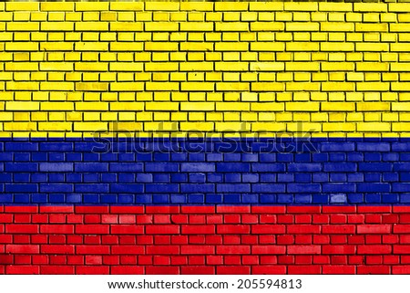 flag of Colombia painted on brick wall