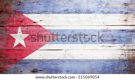 Flag of Cuba painted on grungy wood plank background - stock photo
