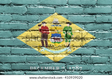 Flag of Delaware State, painted on brick wall - stock photo