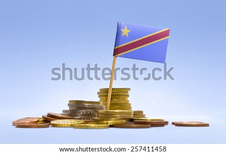 Flag of Democratic Republic of the Congo in a mixed stack of european coins and a blue background.(series) - stock photo