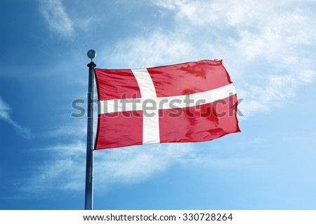 Flag of Denmark on the mast - stock photo