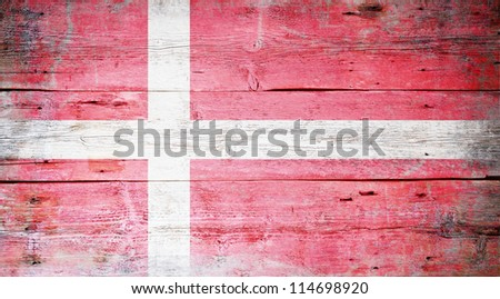 Flag of Denmark painted on grungy wood plank background - stock photo